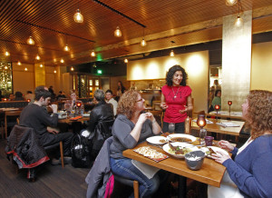 File photo of Meeru Dhalwala and diners at Shanik by Greg Gilbert/The Seattle Times