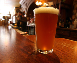 Beer, fresh from a cask, by Greg Gilbert / The Seattle Times.
