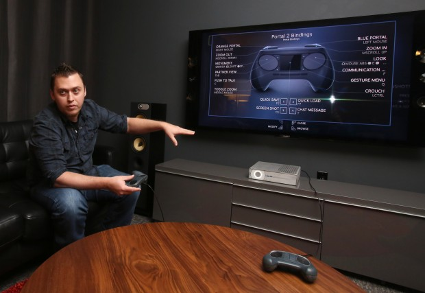Valve designer Eric Hope showing SteamOS running on a Steam Machine. Photo by Ken Lambert, Times staff photographer