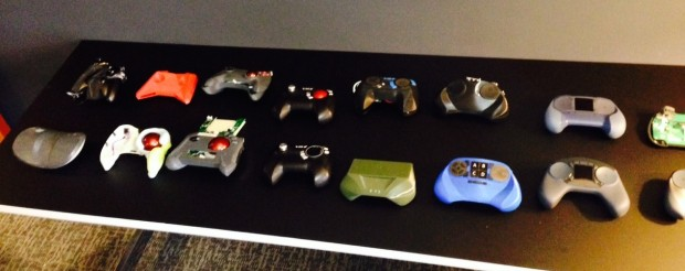 A table of prototypes at Valve's Bellevue office shows the evolution of its controller design.