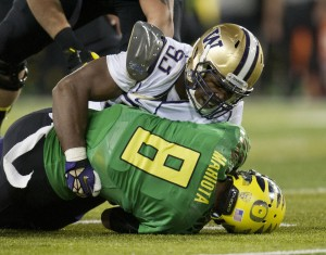 UW's Andrew Hudson sacks Oregon's Marcus Mariota in 2012. (Dean Rutz/The Seattle Times)