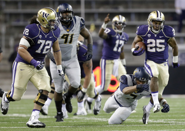 UW running back Bishop Sankey runs in a 59-yard touchdown after eluding the grasp of Cal's Jalen Jefferson just before the half as the the University of Washington takes on Cal at Husky Stadium in Seattle, Saturday October 26, 2013. The Huskies led 24-7 at the half. (Bettina Hansen/The Seattle Times)