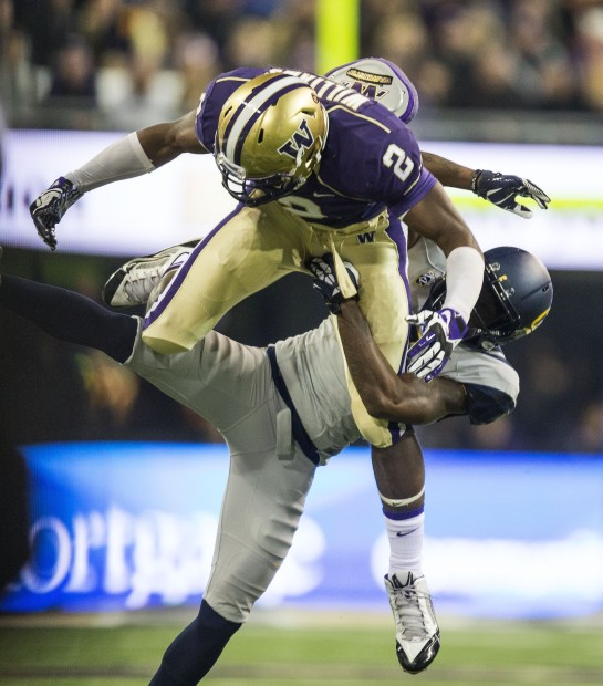 UW wide receiver Kasen Williams goes down on his foot, tangled up with Cal's Kameron Jackson as the University of Washington takes on Cal at Husky Stadium in Seattle, Saturday October 26, 2013. Williams was taken off the field after the play with his foot appearing to be in an air cast. (Dean Rutz/The Seattle Times)
