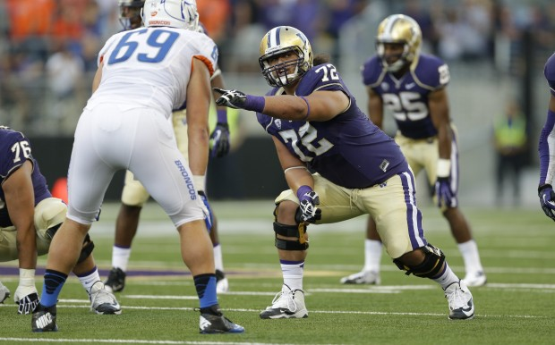 Micah Hatchie started all 13 games at left tackle for UW in 2013. (Ted S. Warren/The Associated Press)