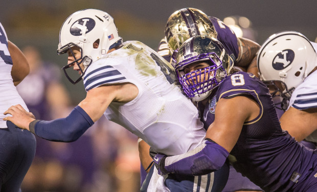 UW's Hau'oli Kikaha sacks  BYU quarterback Taysom Hill late in the Fight Hunger Bowl. (Dean Rutz/The Seattle Times)