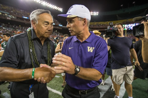 Coaches Norm Chow, left, and Chris Petersen congratulate each other after Washington narrowly defeated Hawaii 17-16 in the season opener for both teams. (Dean Rutz/The Seattle Times)