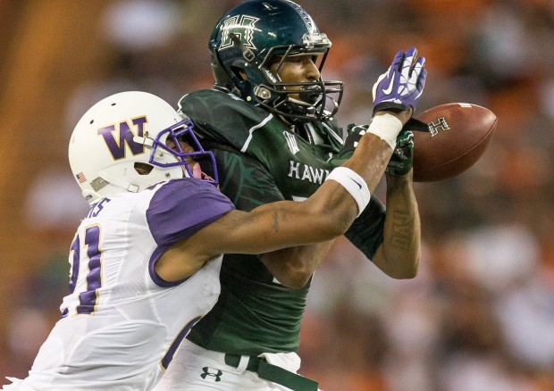 Washington's Marcus Peters breaks up a pass intended for Hawaii's Marcus Kemp. (Dean Rutz/The Seattle Times)