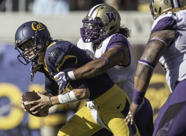 Washington's Hau'oli Kikaha sacks Cal quarterback Jared Goff for a 9-yard loss on third-and-5, setting up a Cal punt in the first half. (Dean Rutz/The Seattle Times)