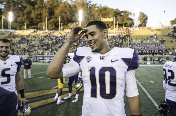 Cyler Miles threw for a career-high 273 yards and three touchdowns in Washington's 31-7 win at California. (Dean Rutz/The Seattle Times)