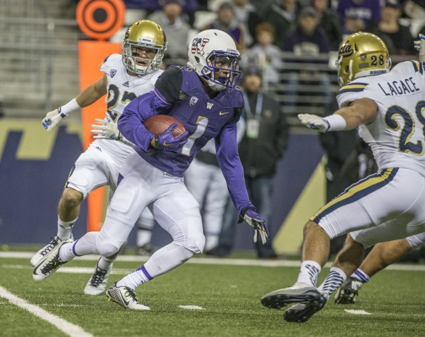 John Ross III returns a kickoff 100 yards for a touchdown against UCLA on Saturday. (Steve Ringman/The Seattle Times)