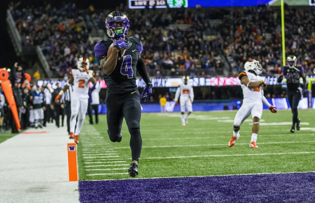 Washington's Jaydon Mickens rushes for a 36-yard touchdown in the fourth quarter to give the Huskies a 30-13 lead over Oregon State. (Dean Rutz/The Seattle Times)