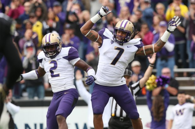 Washington wide receiver Kasen Williams, left, celebrates with running back Shaq Thompson after Thompson's touchdown run against Colorado in the first quarter of an NCAA college football game in Boulder, Colo., on Saturday, Nov. 1, 2014. (AP Photo/David Zalubowski)