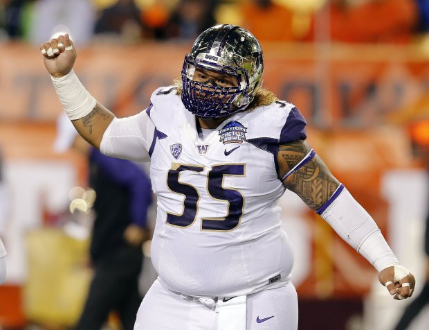 Washington defensive lineman Danny Shelton (55) in the first half during the Cactus Bowl NCAA college football game against Oklahoma State, Friday, Jan. 2, 2015, in Tempe, Ariz. (AP Photo/Rick Scuteri)