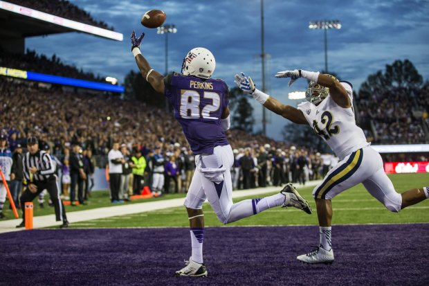 A pass intended for tight end Joshua Perkins is just out of reach in UW's loss to UCLA in November. (Dean Rutz/The Seattle Times)