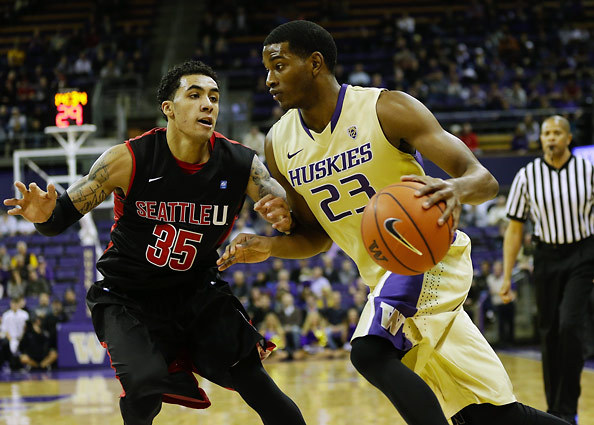 Huskies' guard C.J. Wilcox works down the lane as Redhawk guard Jarell Flora defends during the first half of the annual UW vs. Seattle University game at Alaska Airlines Arena on Sunday, Nov. 10, 2013. Washington led 42-33 at the half. (Lindsey Wasson - Seattle Times)