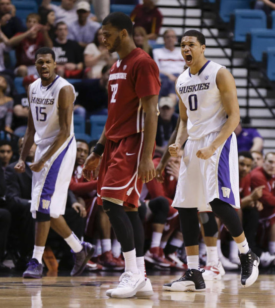 Washington's Scott Suggs (15) and Abdul Gaddy (0) react after a turnover by Washington State's Mike Ladd in the second half during a Pac-12 tournament NCAA college basketball game, Wednesday, March 13, 2013, in Las Vegas. Washington won 64-62. (Julie Jacobson/AP)