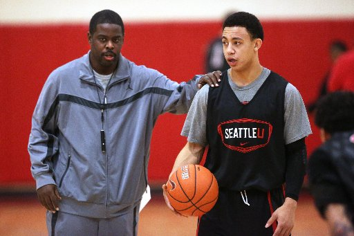 Seattle University coach Cameron Dollar, left, will lean heavily on newcomer Isiah Umpig, right, this season. (Mark Harrison - Seattle Times)