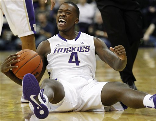 ashington's Hikeem Stewart reacts after being fouled by a Western Washington player in the first half of an exhibition NCAA college basketball game, Wednesday, Oct. 24, 2012, in Seattle. (AP Photo/Elaine Thompson)