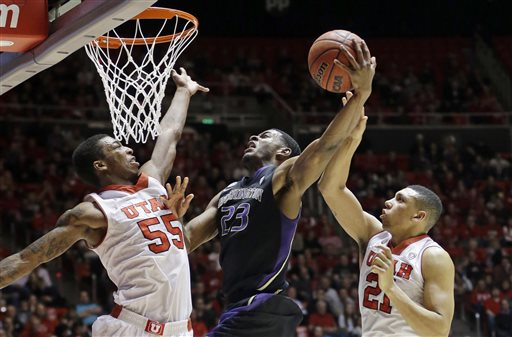 Utah's Delon Wright (55) and teammate Jordan Loveridge (21) defend against Washington's C.J. Wilcox (23) in the second half of an NCAA college basketball game Thursday, Feb. 6, 2014, in Salt Lake City. Utah won 78-69. (AP Photo/Rick Bowmer)