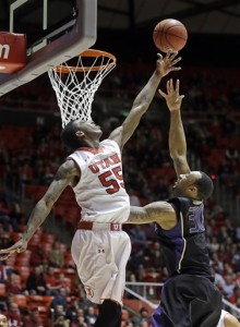 Utah's Delon Wright (55) defends against Washington's Desmond Simmons (30). (AP Photo/Rick Bowmer)