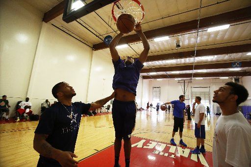 Washington center Robert Upshaw (middle) and Nigel Williams-Goss (right) are expected to lead the Huskies in rebounding and scoring respectively, according to a player survey. (Photo credit: Mark Harrison - Seattle Times)