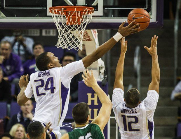 Robert Upshaw gets all ball on Tulane's Louis Dabney - one of 6 blocked shots on the night that included 10-rebounds and 11-points in a 66-57 win. (Photo credit: Dean Rutz - Seattle Times)