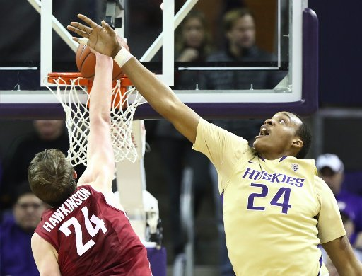 Robert Upshaw, right, needs one block to move into a first-place atop Washington's single-season blocks list. (Photo credit: Lindsey Wasson - Seattle Times)