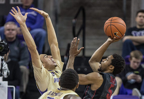 Washington's Nigel Williams-Goss contests a shot by Stanford's Chasson Randle during their game last year Alaska Airlines Arena. UW won 64-60. (Photo credit: Dean Rutz - Seattle Times)