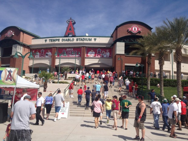 Fans file into Tempe Diablo Stadium in Tempe, Ariz. ahead of today's Mariners game against the Angels.