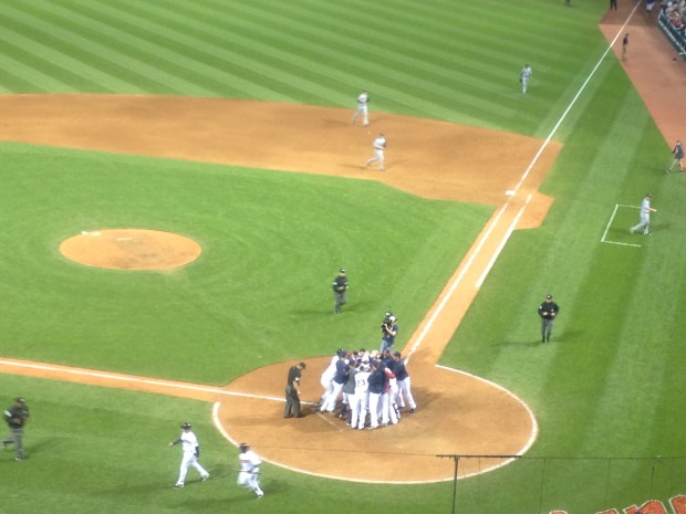 Jason Kipnis is mobbed at home plate after his walkoff three-run homer in the 10th hands the Mariners a 6-3 loss.