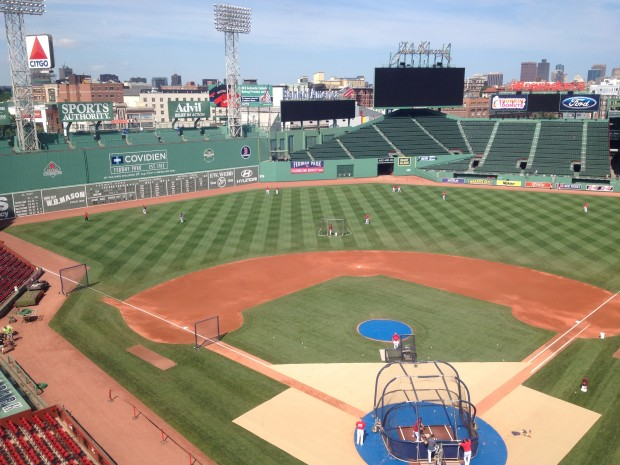 It may look like regular early batting practice at Fenway Park, but really, there's a flurry of activity going on behind the scenes.