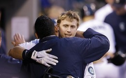 Justin Smoak receives a congratulatory hug in the dugout from pitcher Felix Hernandez after a three-run homer in the sixth inning. Hernandez tossed eight scoreless frames in the 6-0 win. Photo Credit: AP