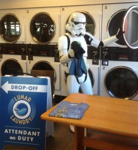 Jesse Mazur, a colleague of GISHWHES team member H.B. Siegel, folds clothes in his Storm Trooper costume for item #5 at Ballard's Lunar Laundry. (Courtesy Vatican Cameos)