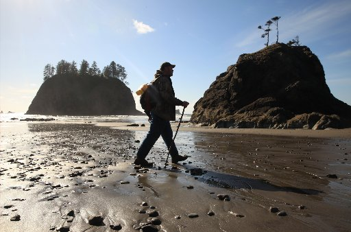 Walking the beach near La Push. (photo by Erika Schultz / The Seattle Times)