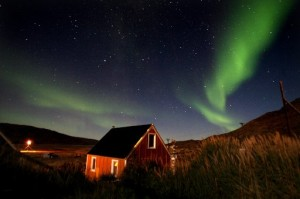 The Aurora Borealis glows in the sky in the Greenland town of Kangerlussuaq.  (Photo by Uriel Sinai/Getty Images, 2007)