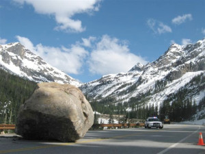 The North Cascades Highway is no stranger to natural forces. This boulder rolled onto the highway in 2010.  And mudslides and avalanches have closed the highway before, beyond its standard winter closing. . (WSDOT photo).