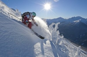 A skier blasts down a powdery slope in a past season at Whistler Blackcomb. (photo by Paul Morrison)