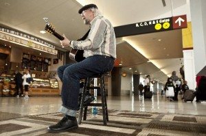 "Dave Harmonson of Seattle, also known as ""Country Dave, "" performs in the A gates at Sea-Tac Airport. The airport has extended its live music program by three years. (photo by Bettina Hansen/The Seattle Times)"