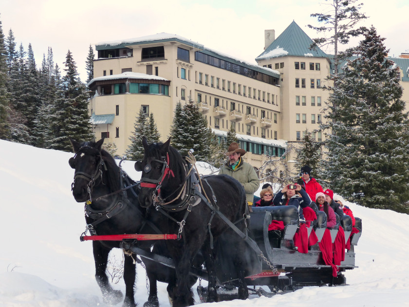 Taking a sleigh ride is one of the wintertime draws at Chateau Lake Louise in Canada. (photo by Brian J. Cantwell/The Seattle Times)