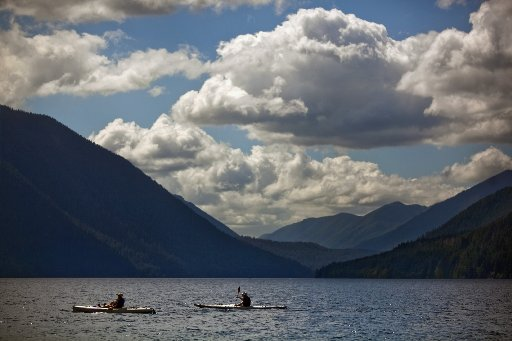 Kayakers paddle Lake Crescent in Olympic National Park. (photo by Bettina Hansen/The Seattle Times)