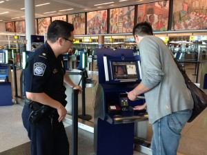 A passenger uses an automated passport-clearance kiosk at New York's JFK airport. (CBP photo.)