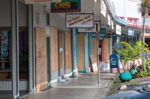 Normally a bustling sidewalk during the day, downtown Hilo's Kamehameha Avenue is almost empty Thursday as storefronts have been boarded up in preparation for Hurricane Iselle. It's  churning toward the Big Island, especially the Hilo coast.
