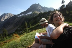 A couple rests after hiking to Cascade Pass in North Cascades National Park. (photo by Erika Schultz / The Seattle Times)
