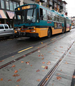A Metro bus operates alongside new tracks on Broadway, where street car expansion pushes south on Capitol Hill.