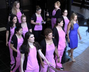 Dr Kirsti Funk, far right, walks in front of nurses from the Pink Lotus Breast Center, before making a statement regarding Angelina Jolie's double mastectomy. Jolie underwent the procedure after learning she had a high probability for breast cancer. (Nick Ut / The Associated Press)