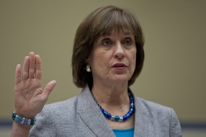 IRS official Lois Lerner is sworn in during an Oversight Committee hearing on Capitol Hill to investigate the extra scrutiny IRS gave to the tea party and other conservative groups that applied for tax-exempt status. Lerner told the committee she did nothing wrong and then invoked her constitutional right to not answer lawmakers' questions. (Carolyn Kaster / The Associated Press)