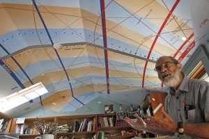 Woody Sullivan shows off the sundial on the ceiling of his garage. An artist drew the ceiling lines after Sullivan calculate dthe angles. To reflect sunlight onto the dial, he mounted a mirror on the windowsill. Sullivan had a hand in creating half of the 26 or so public sundials in this area. (Greg Gilbert / The Seattle Times)