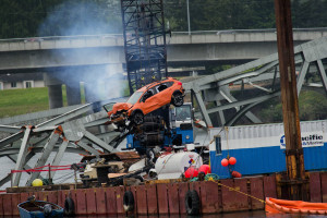 An SUV is removed  from the Skagit River where the Interstate 5 bridge span collapsed. Barges carrying heavy cutting and lifting equipment also retrieved a truck and a travel trailer that fell into the river after an overheight truck load damaged the span. (Marcus Yam / The Seattle Times)