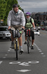 John Pucher, famed Rutgers professor and scholar of bike safety and bikeable cities, rides down Dexter Ave. N. with Robin Randels of Seattle. [Ellen M. Banner, The Seattle Times.]
