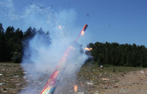Even fireworks can malfunction as this bottle rocket placed in a spent Roman candle tube did when it burned and exploded.  The person holding the tube was not hurt. [Alan Berner, The Seattle Times.]